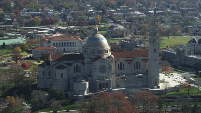 over the basilica of the national shrine of the immaculate conception in washington, dc. shot in november 2011. - shrine stock videos & royalty-free footage