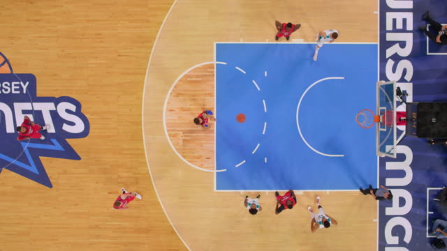 aerial basketball player in red jersey scoring both foul shots. - non us film location stock videos & royalty-free footage