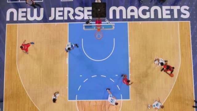 stockvideo's en b-roll-footage met aerial basketball player in red scoring a shot. - buiten de vs
