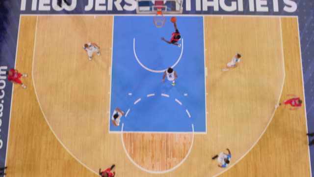 aerial basketball player scoring a shot. - non us film location stock videos & royalty-free footage