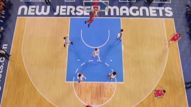 stockvideo's en b-roll-footage met aerial basketball player scoring the slam dunk. - buiten de vs