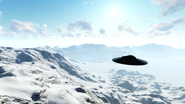 ufo over the mountains in the clouds - saucer stock videos and b-roll footage