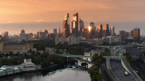 aerial over the schuylkill river approaching the center city, philadelphia at sunrise - philadelphia pennsylvania stock videos & royalty-free footage