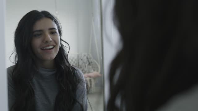 over the shoulder close up of smiling teenage girl examining hair in mirror / lehi, utah, united states - lehi stock videos & royalty-free footage