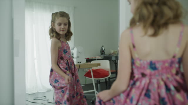 over the shoulder view of reflection of girl in mirror turning and admiring dress / lehi, utah, united states - lehi stock videos & royalty-free footage