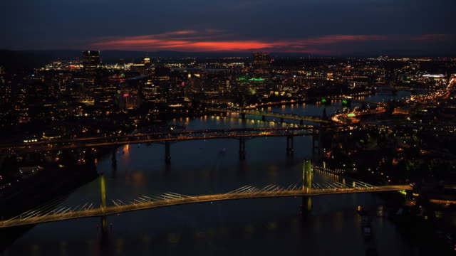 AERIAL Over the Tilikum Crossing on the Willamette River in Portland at night
