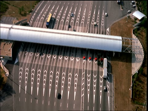 AERIAL over traffic going thru toll booths + highway / Autoroute de soleil, Peage, Provence, France