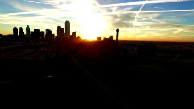 Over Trinity park Overlook towards Downtown Dallas Texas as sunrises behind Reunion Tower