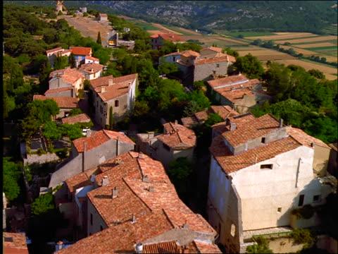 AERIAL over village on hilltop (St Julien?) / Provence / France