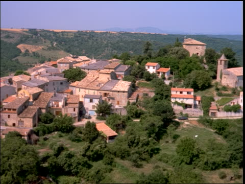 aerial over village on hilltop / provence, france - cinematography stock videos & royalty-free footage