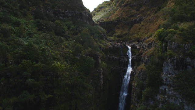 Over waterfalls on Molokai to view of rocky stream