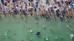 overcrowded beach vacation top view. Having fun on beach summer vibes