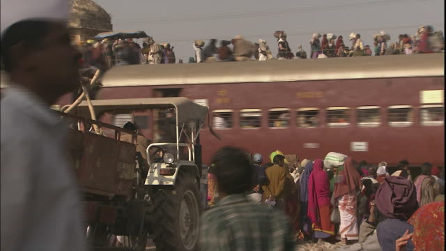 Overcrowded train passes through Allahabad, Uttar Pradesh, India