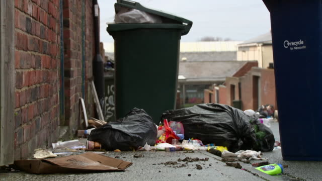 overflowing wheelie bins in back lanes, uk - newcastle upon tyne video stock e b–roll