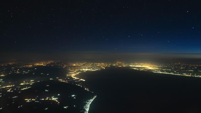 overflying greece and athens by night time lapse - thessalonika stock videos & royalty-free footage