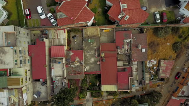 overhead aerial, building rooftops in mexico city - herauszoomen stock-videos und b-roll-filmmaterial