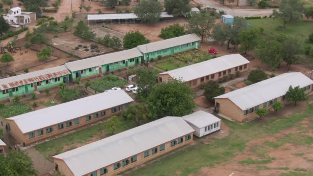 overhead aerial shot of a school in south africa - school building stock videos & royalty-free footage