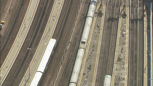 overhead aerial shot of london subway trains on outdoor tracks. - music or celebrities or fashion or film industry or film premiere or youth culture or novelty item or vacations stock videos & royalty-free footage