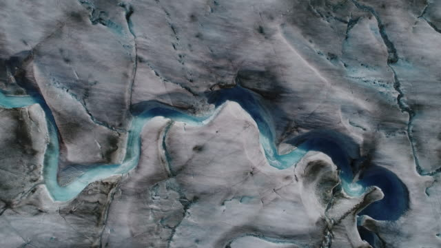 overhead aerial view of river of melting water on sawyer glacier in tracy arm, southeastern alaska - waterfall stock videos & royalty-free footage