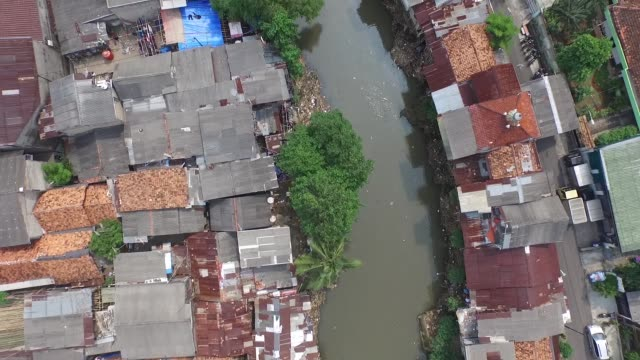 overhead aerial views of shanty houses perched on stilts along a river in jakarta indonesia on tuesday june 23 2015 - stilts stock videos and b-roll footage