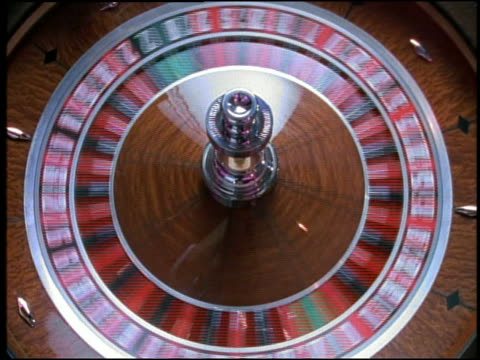 overhead close up roulette wheel spinning - roulette wheel stock videos and b-roll footage