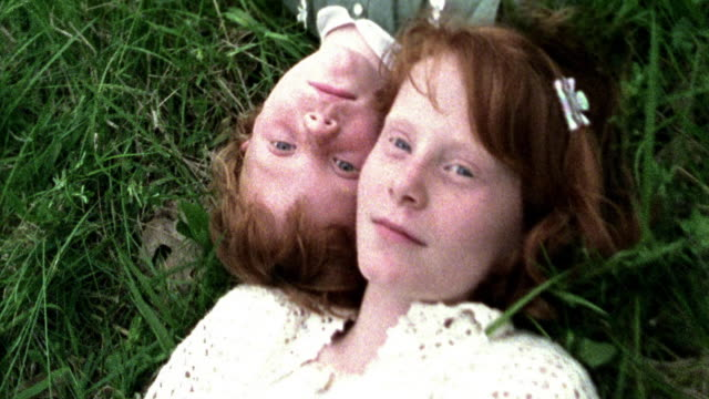 overhead close up two redheaded girls lying in grass / missouri - lying down stock videos & royalty-free footage