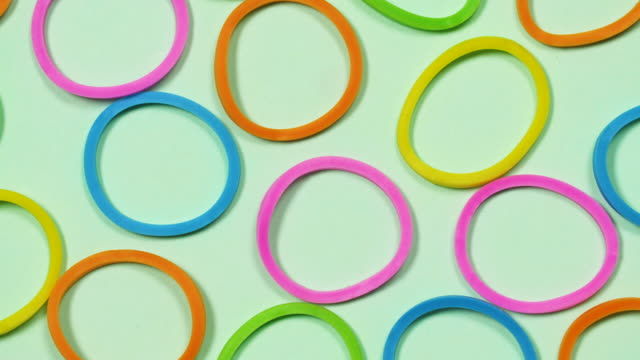 cu overhead colourful circles rotate - green background stock videos & royalty-free footage