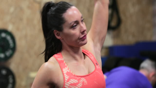 overhead dumbbell press at gym - role reversal stock videos & royalty-free footage
