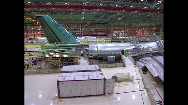 overhead establishing shot of a plane being manufactured at the boeing renton factory in seattle, washington. - seattle stock videos & royalty-free footage