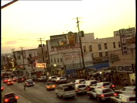 overhead of busy street in tijuana - tijuana stock videos & royalty-free footage