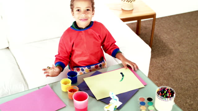 hd: overhead of little biracial boy finger painting - finger painting stock videos and b-roll footage