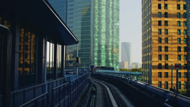 Overhead railway train arrves at Shinbashi Station, Yurikamome line. Speeded up.
