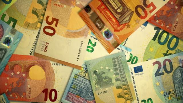 stockvideo's en b-roll-footage met overhead roterend schot van veelvoudige euro op een lijst, munt van de europese unie - tien euro