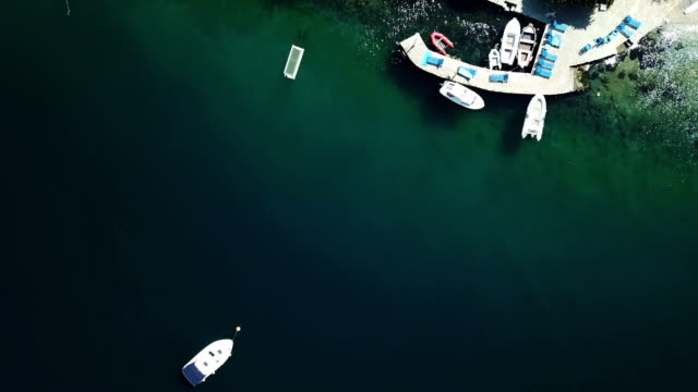 overhead shoot of anchored boat and the beach - anchored stock videos & royalty-free footage