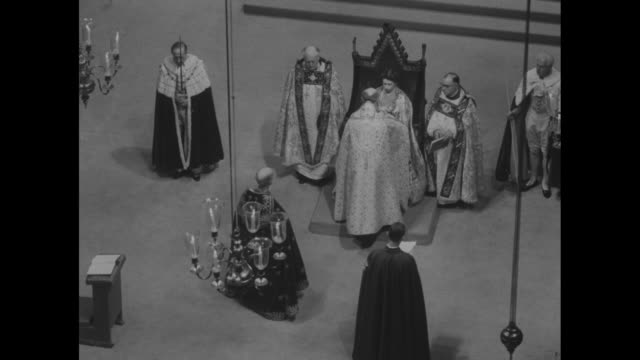 overhead shot archbishop of canterbury places the orb of gold in elizabethõs hands / elizabeth seated on coronation chair flanked by harold... - archbishop of canterbury stock videos & royalty-free footage