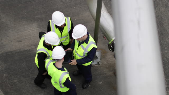 overhead shot group of industrial coworker workers on site with digital tablet - arbeitssicherheit stock-videos und b-roll-filmmaterial