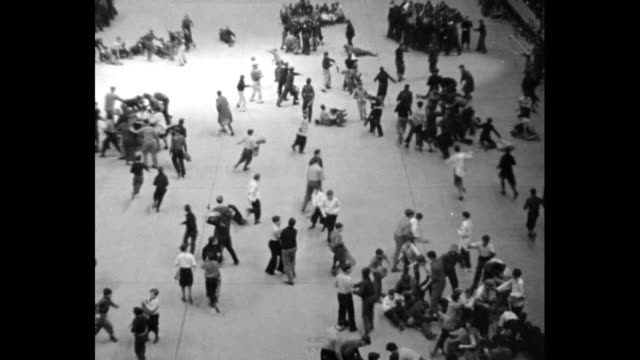 overhead shot of boy scouts on floor of madison square garden marching around large structure looking like large melting pot with ladders leaning on... - scout association stock videos & royalty-free footage