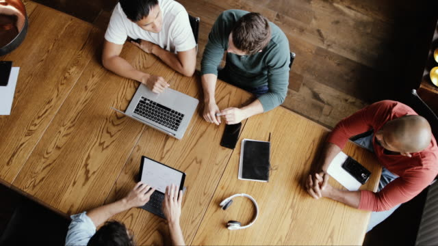 overhead shot of coworkers in a business meeting - entrepreneur stock videos & royalty-free footage