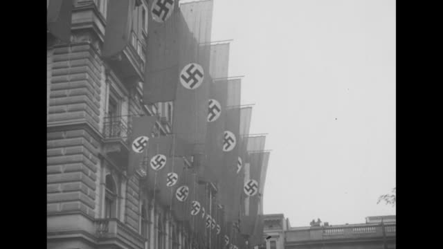 overhead shot of crowd / row of large nazi flags with swastikas hanging from building / two wider shots of nazi flags hanging from building / boys... - nazism stock videos and b-roll footage