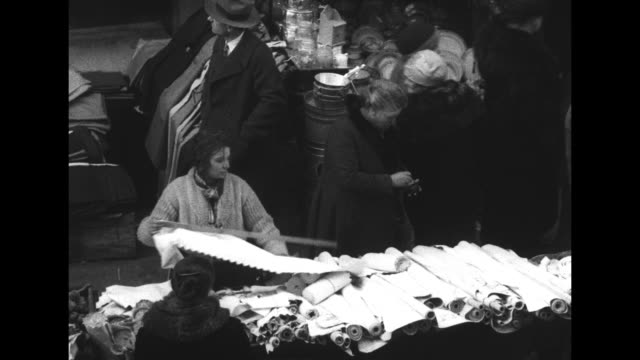 overhead shot of crowded market along street / closer overhead shot of market / peddler arranging her merchandise as people walk buy / women's... - cart stock videos and b-roll footage