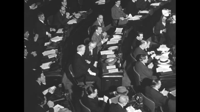 overhead shot of delegates at 8th pan-american conference / united states secretary of state cordell hull takes his seat to applause / spanish... - 外交点の映像素材/bロール
