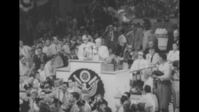 overhead shot of demonstration for pres harry truman in convention hall after his name is placed in nomination / clerk of convention stands at podium... - sam rayburn video stock e b–roll