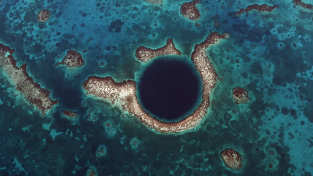 overhead shot of great blue hole - reef stock videos & royalty-free footage