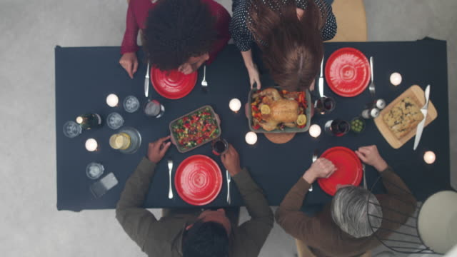 Overhead shot of group of adult friends having a dinner party