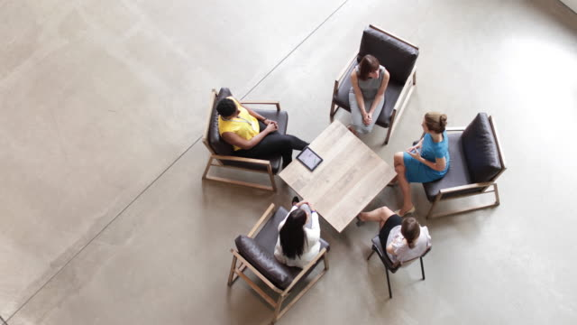 overhead shot of group of businesswomen in a meeting - business relationship stock videos and b-roll footage