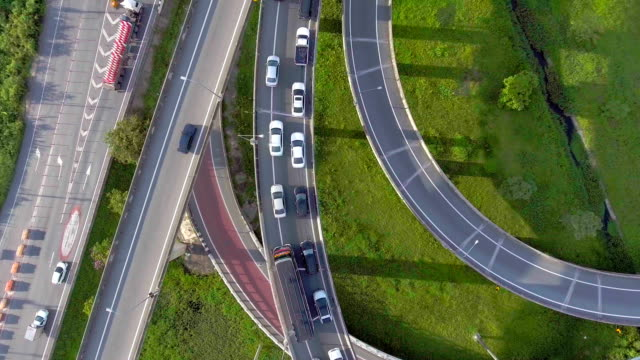 overhead shot of highway and traffic in bangkok, thailand, aerial view - curve stock videos & royalty-free footage