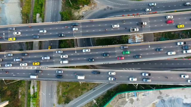 overhead shot of highway traffic in bangkok, thailand, aerial video - road junction stock videos & royalty-free footage