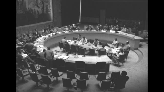 overhead shot of members of un general assembly sitting at large circular desk / audience in gallery watching / overhead shot of delegates sitting at... - united nations general assembly stock videos & royalty-free footage