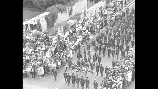 overhead shot of military marching band marching down street followed by soldiers riding horses in formation crowds in bleachers on either side /... - field marshal stock videos and b-roll footage