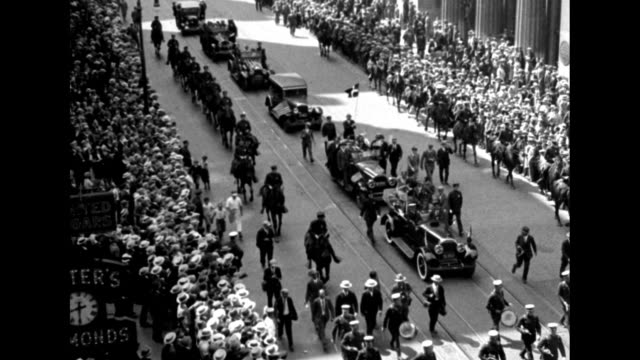 overhead shot of parade with motorcade and mounted policeman coming down broadway crowds on either side / closer view of motorcade and amelia gade... - ticker tape stock videos and b-roll footage